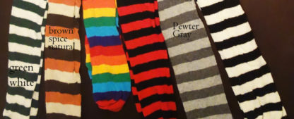 Two pairs of black and white striped stockings; a pair of red and black striped stockings; brown and light brown striped stockings; brown, tan and orange striped stockings; and rainbow striped stockings with orange, yellow, green, blue, black and red.