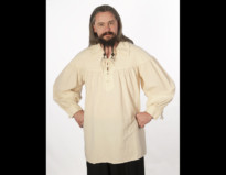 Man standing with hands on hips wearing natural colored Pro Series Blackbeard natural colored shirt with opening at top.