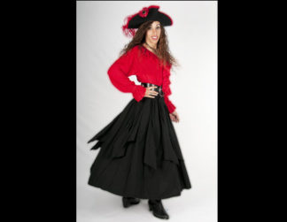 Woman wearing red shirt, black skirt and black hat.